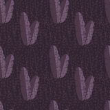 Seamless pattern with jungle palm leaves on purple background Stock Photography