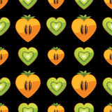 Seamless pattern of kiwi, persimmon in Heart on bl Stock Photos