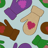 Seamless pattern of knitted mittens Royalty Free Stock Photos