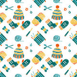 Seamless pattern on a knitting theme, things. Vector seamless pattern on a knitting theme in bight colors, knitted things Royalty Free Stock Photos