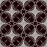 Seamless pattern of lace cloth. White ornament on a dark background. Royalty Free Stock Image