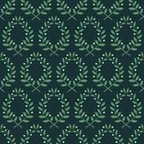 Seamless pattern with laurel branches on a blue background Stock Images
