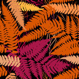 Seamless pattern with leafs tropical fern palm for fashion textile or web background. orange pink brown silhouette on Black backgr Royalty Free Stock Photos