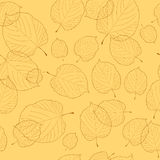 Seamless pattern of leaves on beige background Royalty Free Stock Image