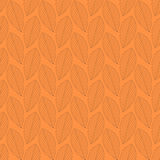 Seamless pattern of leaves on an orange background. Stock Image