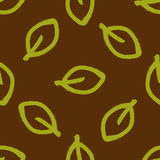 Seamless pattern with leaves painted by hand rough brush. Grunge, sketch, graffiti. Green, brown. Vector illustration Stock Photography