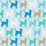 Blue cats  silhouette seamless pattern.. Colorful cats pattern over blue background. Simple vector illustration Stock Photos