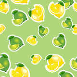 Seamless pattern with lemons and limes with leaves and slices stickers. Light green background. Royalty Free Stock Photography