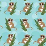 Seamless pattern lemur on green branch on blue Royalty Free Stock Image
