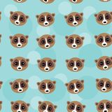 Seamless pattern lemur muzzle on blue background. Royalty Free Stock Photos