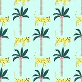Seamless pattern of leopards and palm trees on a blue background. royalty free illustration