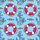 Seamless pattern with lifebuoys and anchors Royalty Free Stock Photos