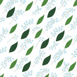 Seamless pattern of Lily of the valley sprigs with leaves on a white background. Seamless pattern of Lily of the valley sprigs with leaves on a white background Royalty Free Stock Photo