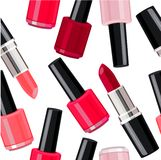 Seamless pattern - lipsticks and nail varnishes. Royalty Free Stock Photo