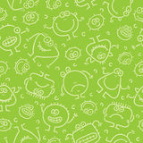 Seamless pattern with little monsters. Green seamless pattern with little monsters Royalty Free Stock Image