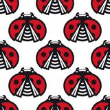 Seamless pattern of little spotted red ladybugs Stock Photo
