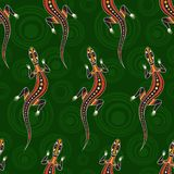 Seamless pattern of lizards. Australian art. Seamless pattern of lizards with abstract circles on background. Australian art. Aboriginal painting style. Vector stock illustration