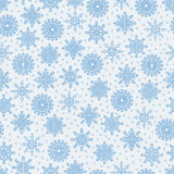 Seamless pattern with lots of snowflakes on a whit Stock Images