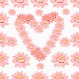 Seamless pattern lotus of flower pink in heart shape. Royalty Free Stock Photos