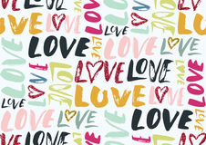 Seamless pattern with love words, hearts. Stock Photo