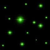 Seamless pattern of luminous stars. Illusion of light flashes. Green flames. Royalty Free Stock Images