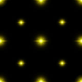 Seamless pattern of luminous stars. Illusion of light flashes. Yellow flames. on black backgroun. Seamless pattern of luminous stars. Illusion of light flashes Royalty Free Stock Photography