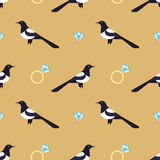 Seamless pattern with luxury golden rings and magpies. Stock Image