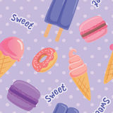 Seamless pattern with macaroon cookies, ice cram and popsicle on polka-dots background.   Stock Images