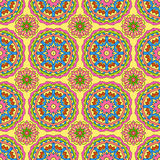 Seamless pattern made from abstract circle mandala. On orange background Stock Photos