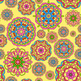 Seamless pattern made from abstract circle mandalas. On orange background Royalty Free Stock Images