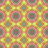 Seamless pattern made from abstract mandala. On yellow background Royalty Free Stock Photography