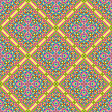 Seamless pattern made from abstract mandala. On yellow background Stock Photo