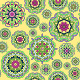 Seamless pattern made from abstract mandalas. Seamless pattern made from abstract circle mandalas on orange background Stock Photos