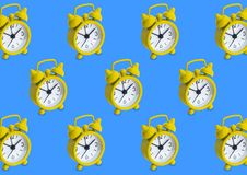 Seamless pattern made of golden analogue clocks in isolated blue. Background Stock Images