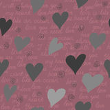 Seamless pattern made of hearts and romantic handwritten words i Stock Photo