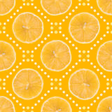 Seamless pattern made of Lemon slice isolated and dots on a yellow background. Flat lay top view from above, juicy fruit stock photos