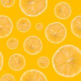 Seamless pattern made of Lemon slice isolated on a yellow background. Flat lay top view from above, juicy fruit Stock Photography