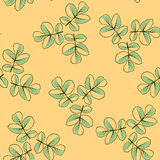 Seamless pattern made from rose leaves. Seamless pattern made from green rose leaves on cream background Royalty Free Stock Image