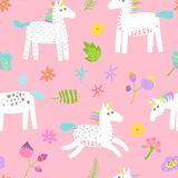 Seamless Pattern with Magic Unicorns and Tropical Flowers. Childish Fairytale Background for Fabric Textile, Wallpaper. Wrapping Paper, Decoration. Vector Royalty Free Stock Photography