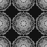 Seamless pattern with Mandalas. Vector white ornaments on black background Stock Photo