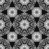 Seamless pattern with Mandalas. Vector white ornaments on black background Royalty Free Stock Photography