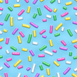 Seamless pattern with many decorative sprinkles. Seamless pattern of blue donut glaze with many decorative sprinkles. Vector illustration Eps 10 Stock Photos