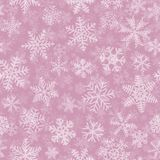 Seamless pattern of many layers of snowflakes. Christmas seamless pattern of many layers of snowflakes of different shapes, sizes and transparency. White on pink Stock Image