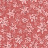 Seamless pattern of many layers of snowflakes. Christmas seamless pattern of many layers of snowflakes of different shapes, sizes and transparency. White on Stock Image