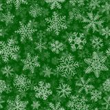 Seamless pattern of many layers of snowflakes. Christmas seamless pattern of many layers of snowflakes of different shapes, sizes and transparency. White on Royalty Free Stock Photography