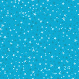 Seamless pattern of many snowflakes on blue background. Christma. S winter theme for gift wrapping. New Year seamless background for website Stock Photos