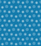 Seamless pattern of many white snowflakes on blue background. Ch. Ristmas winter theme for gift wrapping. New Year seamless background for website Stock Image