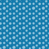 Seamless pattern of many white snowflakes on blue background. Ch. Ristmas winter theme for gift wrapping. New Year seamless background for website Royalty Free Stock Images