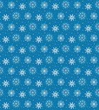 Seamless pattern of many white snowflakes on blue background. Ch Royalty Free Stock Photo