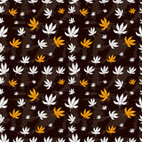 Seamless pattern of marijuana leaf on a brown Royalty Free Stock Photos